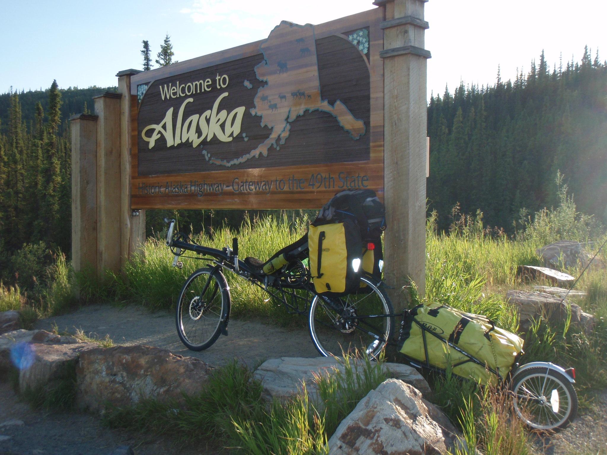 Bike at Alaska sign at Canadian border