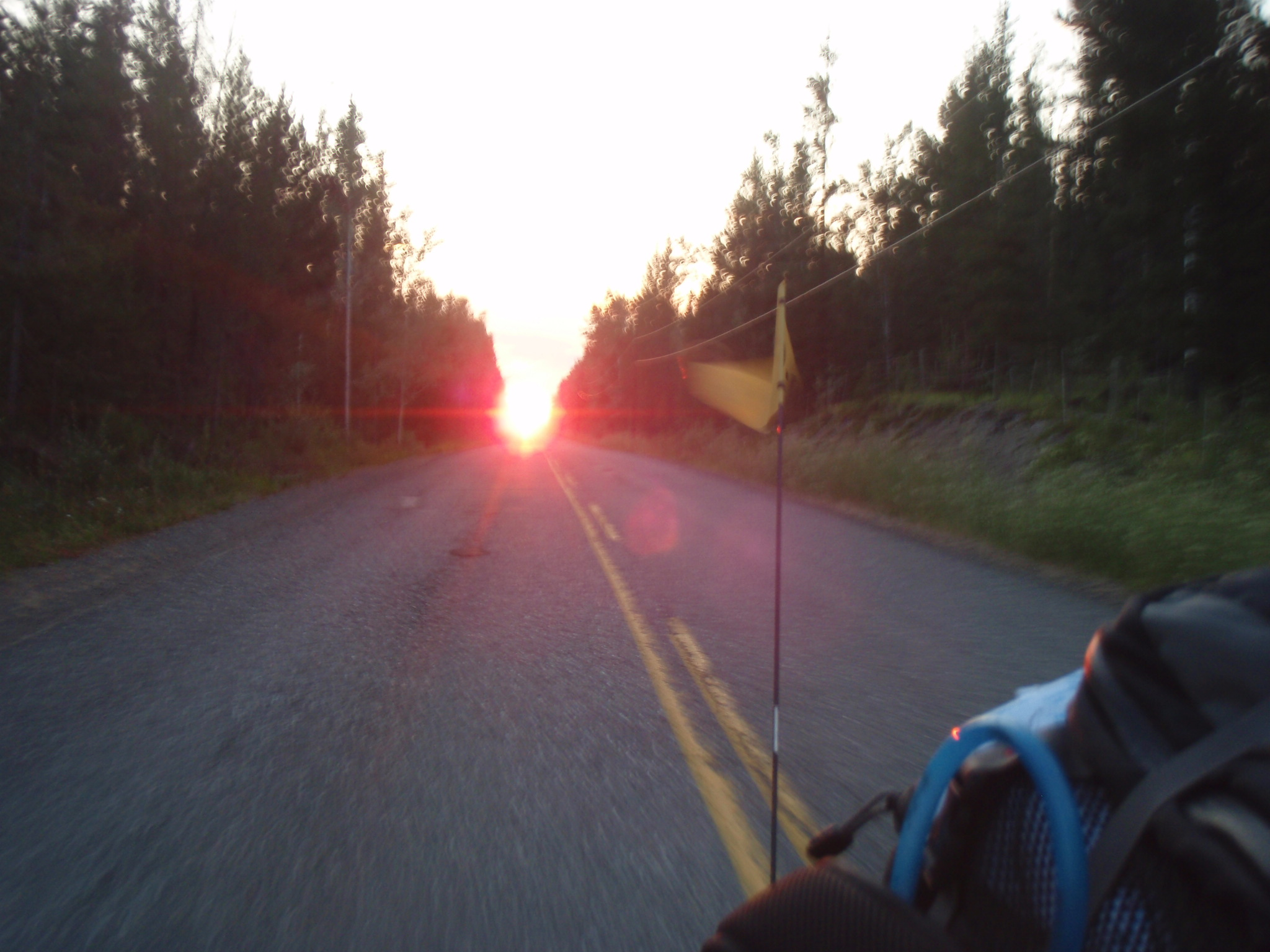 Sun about to set near Green Lake in rearview
