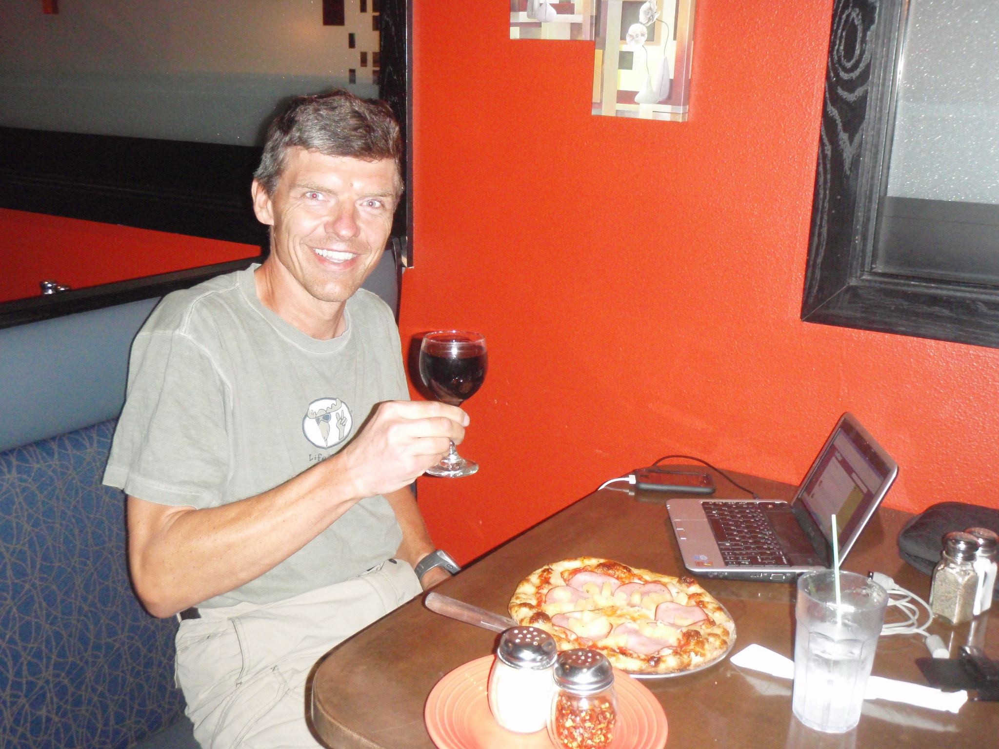 Celebrating the completion of the Canada portion of my ride with Wine and Pizza