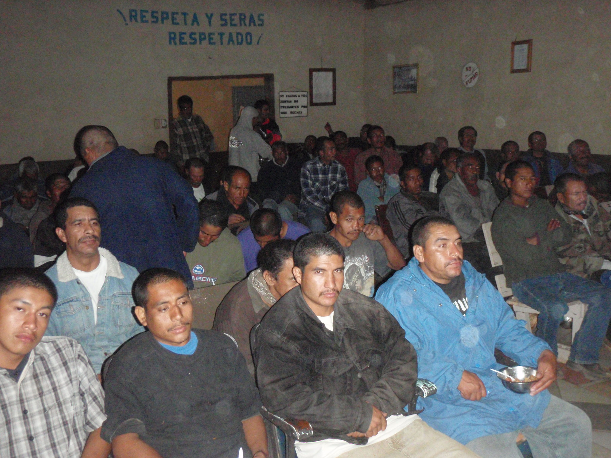 Men at Colonet drug rehab station during a Christian DVD concert showing