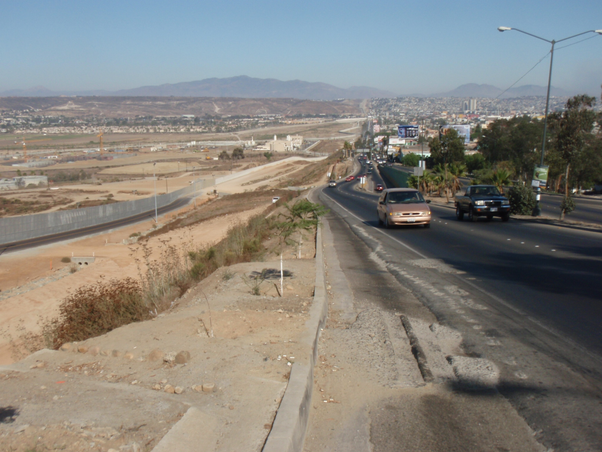 View of border fence in Tijuana (US to the left, Mexico to the right)
