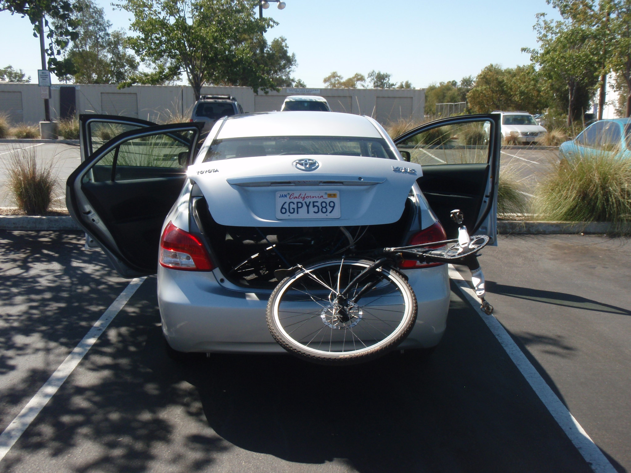 Recumbent sticking out of the back of small rental car