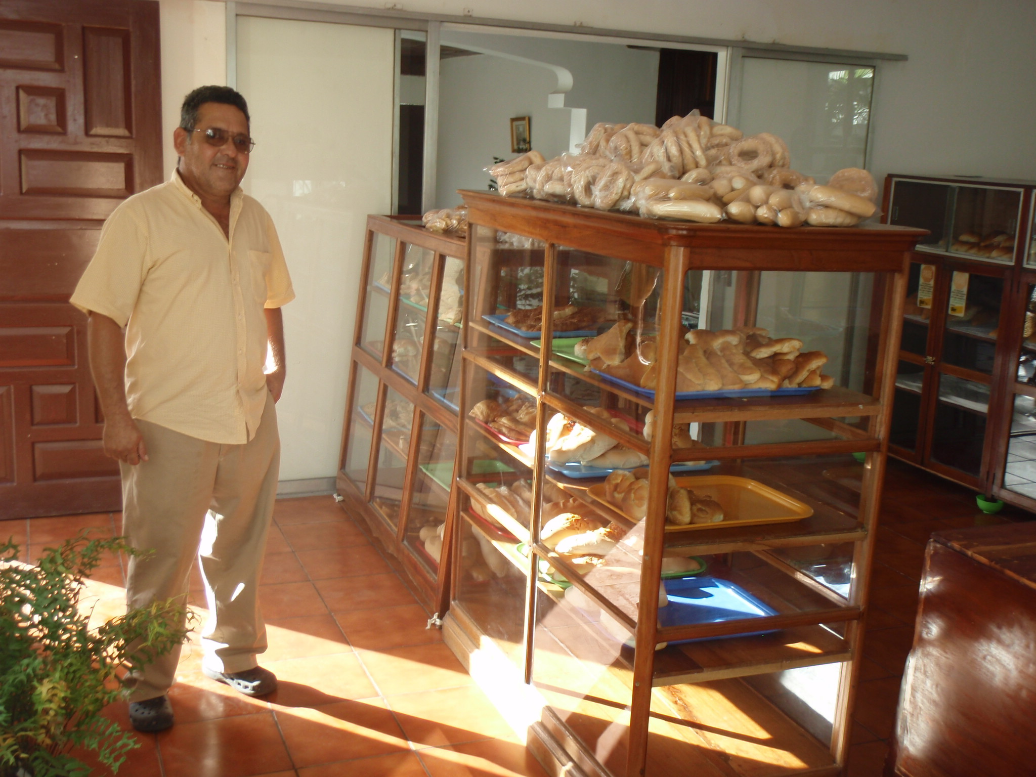 Ivan running the bakery store who invited me into his home for coffee and conversation