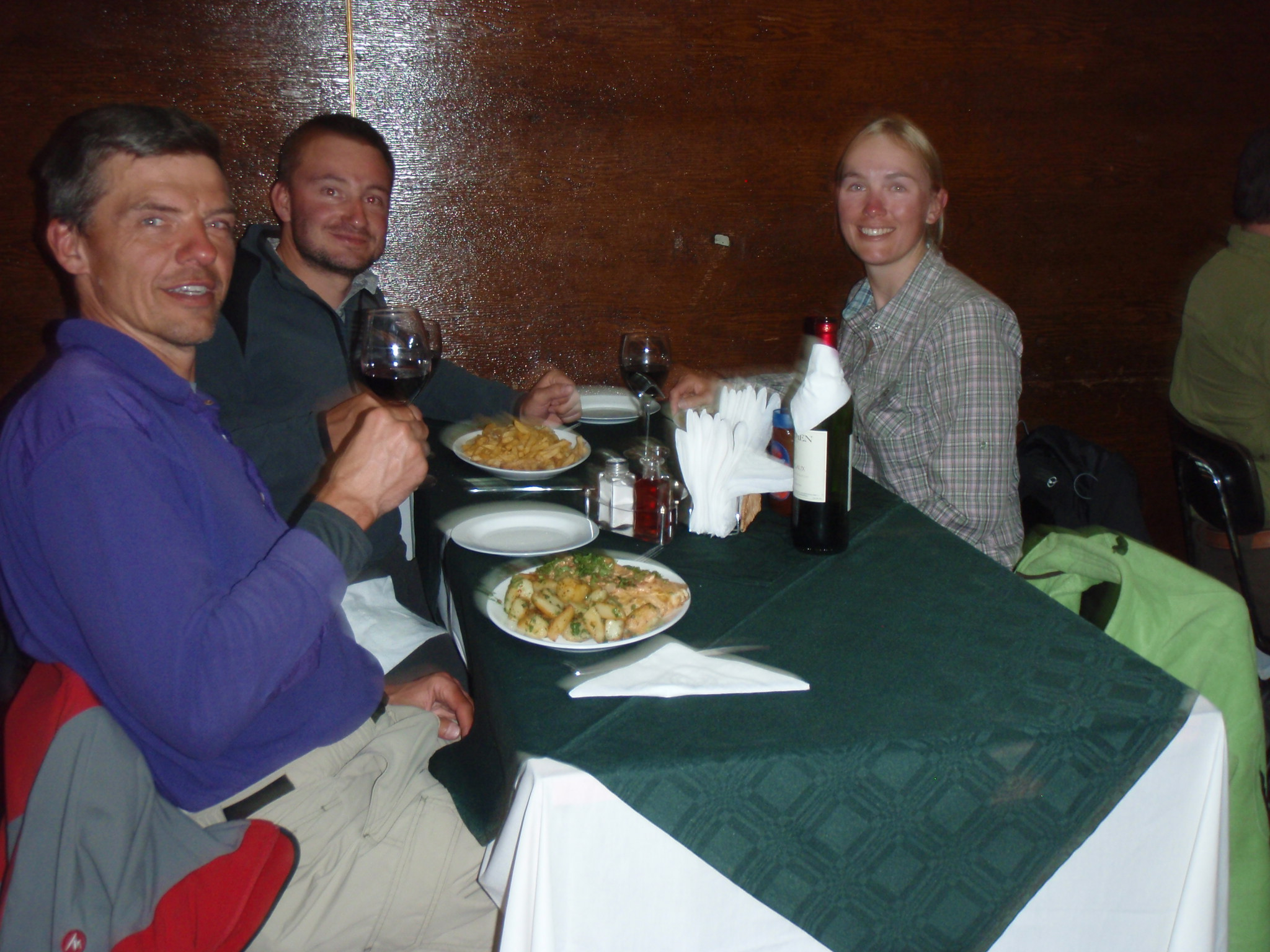 Chatting with Belgian cyclists Ellen and Nicolas about the Carreterra Austral over dinner in Coyhaique