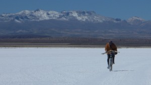 Another cyclist a world apart: A local riding to work cutting salt for a living
