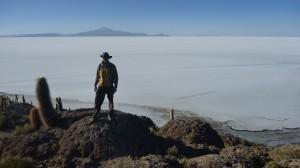 Standing on the Isla Incahuasi surrounded by the salt flats of the Salar de Uyuni
