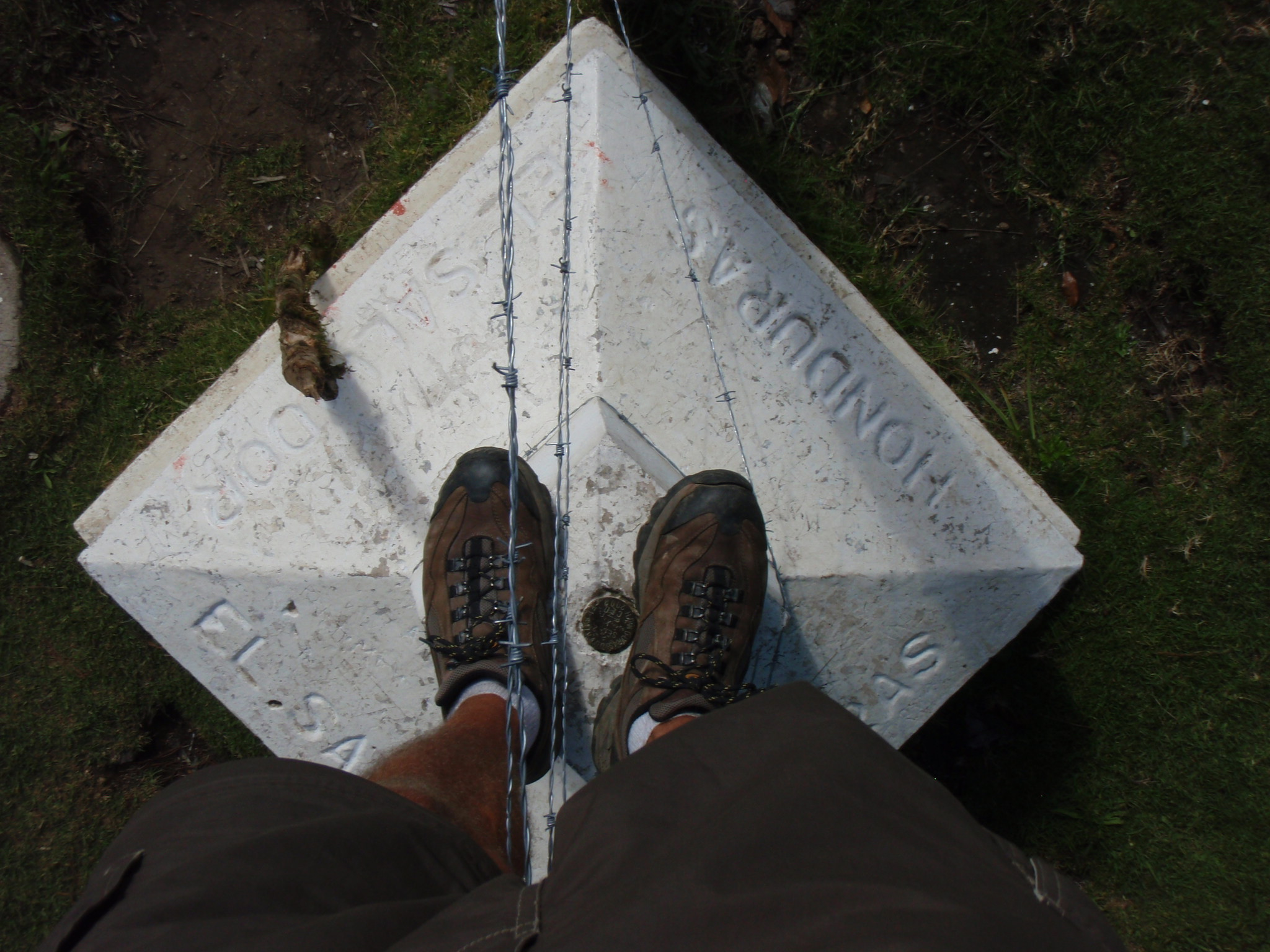 Standing with one foot in El Salvador (on highest point) and one foot in Honduras